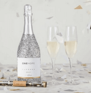 gift guide one hope sparkling wine glitter bottle